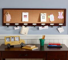 Ooh, I like this for the mud room.  And it's on sale, too!!  Family Weekly Corkboard | Pottery Barn Kids