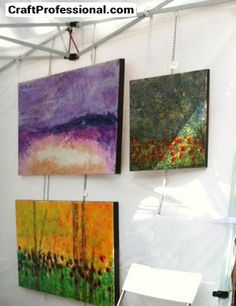 Paintings hung from chain