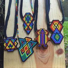 Rainbow Sale!! 25% off All #rainbowbeadwork Talismans & Pendants in my etsy shop. Coupon code is RAINBOW7 these pictured & more! www.etsy.com/shop/lulubeadingbear  #beadwork #beadswag #beadedtalismans #miyukidelicas #etsysale #comanchestitch #beadart #rainbowlife #rainbowswag