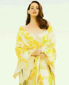 Lana Del Rey yellow floral shawl auburn curled hair eyes closed