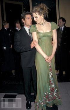 Nicole Kidman at the premiere of Portrait of a Lady. I will never not love this dress. Also, Tom Cruise is not very tall.