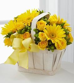 The FTD® Uplifting Moments™ Bouquet is a guaranteed way to lift any mood and spread cheer with each sunlit petal! Bright yellow gerbera daisies and spray roses burst with vibrant energy arranged among Basket Flower Arrangements, Rose Arrangements, Flower Box Gift, Flower Boxes, Amazing Flowers, Beautiful Flowers, Get Well Flowers, Mellow Yellow, Bright Yellow