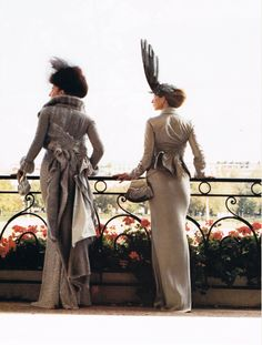 Christian Dior Couture - vintageesque.  I would so wear the dress on the right.  Not so sure about the flying hat accessory.