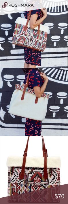 "🌺🌺Gorgeous Reversible Tribal Print Tote🌺🌺 This Beautiful tote bag has a faux fur lining and a double handle.  Flip this tote inside out to ""rock"" the faux fur lining as a new tote bag!!!  Bag is 13"" H x 17 1/2"" W x 6"" D.  🌺🌺🌺🌺🌺🌺🌺🌺🌺 Serendipity by Design Bags Totes"