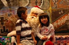 Asian-American Santa meeting this brother-sister duo and asking what they want for Christmas.  At Wing Luke Museum for Member Appreciation Day.  12/8/12