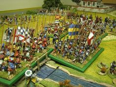 This week we finished off the Battle of Garigliano. Peter swapped sides and took over from Don as Gonsalvo de Coroba. Graham took sole command of the now depleted French. I persisted in taking the Spanish at the French bridge because I was determined to get over it and barge my way into Formia.  At the French Bridge: The Italians stormed over the bridge and crossed pikes with the French.The Landsknechts which had against my wishes been awaiting their moment finally got the gist of the…