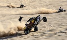Fun, but potentially lethal: A sand rail pulls off a wheelie as two quad bikes roar up in the distance. In a tragic twist to the festival, a man died when his all-terrain vehicle rolled over. He was not wearing a seatbelt or helmet Trail Motorcycle, Sand Rail, Sand Toys, Buggy, Bike Trails, Go Kart, Car Pictures, Motocross, Terrain Vehicle