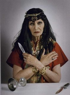 """""""Merrie England"""": Tim Walker Shoots English Folk Culture for Vogue UK July 2011. Pictured is Aunty Bunty, witch.  Boasting 14 covens, vermillion robes and an  inverted pentagram, there's nothing cuddly about Maureen Wheeler aka Aunty Bunty.  """"I'll only curse someone if it is for justice,"""" says Aunty Bunty. """"If someone hurts an animal, or a member of my family..."""""""
