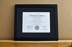 "Style: Medium Frame Color: Black Mat: 2"" Black Diploma: 11"" W x 8 1/2"" H"