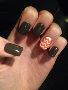 gray nails with a bright chevron nail art accent