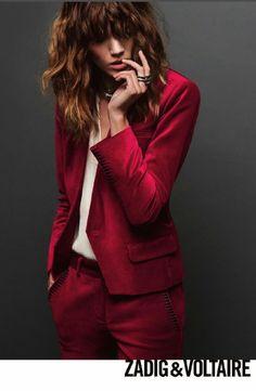 Red collarless blazer.