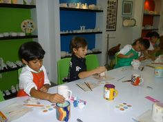 Painting pottery in Café Pintado.