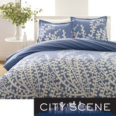 City Scene Branches French Blue 3-piece Duvet Set at overstock.com from $48.44 to $79 depending on size.  I adore the contemporary pattern and the French blue color.  Truly stylish and this comforter is reversible.