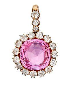 A pink sapphire and diamond pendant.