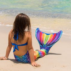 Bursting with a kaleidoscope of colors, Fin Fun's Rainbow Reef swimmable mermaid tail presents a dramatic display of hues your fellow pool goers will never forget · Reinforced Tail Tip Technology · Fade-Resistant Fabric · Sizes for Kids & Adults