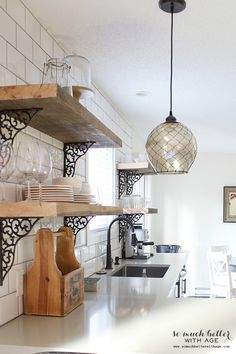 Decorative wrought iron brackets and reclaimed wood shelves