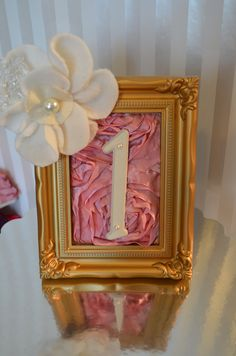 cute framed table numbers...maybe minus the flower?