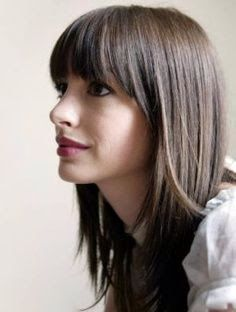 Layered hair with curved bangs.