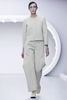 pale grey pants suit:  zip-front cropped box jacket, long trouser with   volume at knee ... simple, elegant    J.W. Anderson, S/S 2013