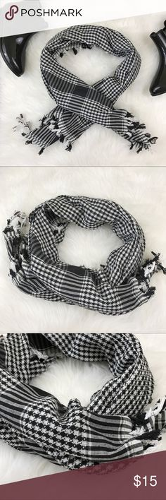 Black & White Fringe Scarf Oversized black and white multi-pattern scarf with fringe tassels at the hem. Houndstooth and striped sliver pattern. No flaws. Accessories Scarves & Wraps