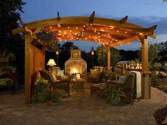 outdoor fireplace and patio design. Pavers set in a radius pattern to define the space. Outdoor kitchen, outdoor fireplace, patio furniture and a pergola - what more do you need to set the stage for outdoor living? Outdoor Living Rooms, Outside Living, Outdoor Spaces, Living Spaces, Outdoor Kitchens, Pergola Diy, Cedar Pergola, Curved Pergola, Outdoor Pergola