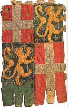 14th-century lion and cross banner of the Blonays family.  Applique and embroidery, 45 by 27 centimeters