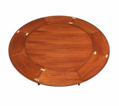 Rare Danish Modern Teak Round Expandable Top Dining Table | From a unique collection of antique and modern dining room tables at https://www.1stdibs.com/furniture/tables/dining-room-tables/