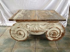 Distressed capital coffee table
