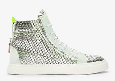 Priced at $695 you can find these Giuseppe Zanotti Metallic Silver Scaled London Sneakers at Ssense online store.    High top leather sneakers in metallic silver with embossed oversize scale texture throughout. Round toe. White lace up closure. Z
