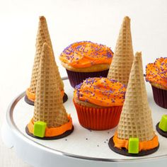 Halloween Witch Hats  Note:  Put foil over a bunt pan and poke holes to hold the batter filled cones.