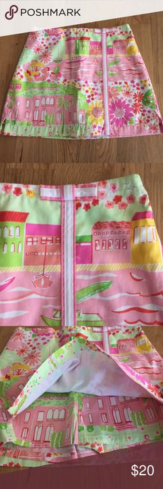 "Lilly Pulitzer Skirt/Skort Lilly Pulitzer Girls Negresco ""Multi Mediterranean"" 2005 Lennie Skort Pink green and yellow skirt withy Nice, France negresco seaside scene with sailboats, palm trees and buildings. Built in shorts. Excellent condition. Lilly Pulitzer Bottoms Skorts"