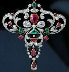 Burma ruby, calibrè-set emerald, pear-shaped diamond, marquise-cut diamond, gold and platinum pendant and chain. This impressive necklace i... Edwardian
