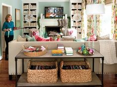 I like the large woven baskets for books, etc.  That would work well in the living room for books, toys, etc.