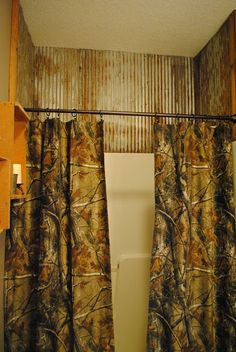 Recycled barn tin shower wall~Irishman Acres~ The shower curtain doesn't thrill me all that much but the shower stall itself is wonderful. Camo Bathroom, Laundry In Bathroom, Bathroom Ideas, Garage Bathroom, Restroom Ideas, Downstairs Bathroom, Bath Ideas, Master Bathroom, Tin Shower Walls