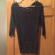 Express black sparkling see through sweater Hardly ever worn. Black holey sweater with silver threading to make the sweater sparkle.  Perfect for the holidays. 74% Rayonne / 17% polyester / 9% metallise Express Sweaters