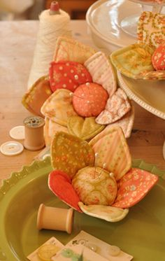 flower pincushions....would also be adorable enlarged as throw pillows!
