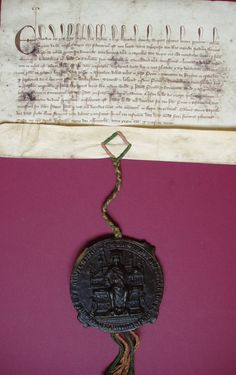 Royal Letters Patent of King Edward I, licensing William Carleton to give lands in Bricett (one messuage and 60 acres) and an annual rent of 3 s. 6 d. to the Prior of Bricett in exchange for 60 acres of land in Wathesham.  3 November 1305  King Edward's Great Seal is attached