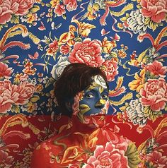 Peruvian artist Cecilia Paredes uses a mix of make-up, paint and costumes to make herself disappear in her own paintings. Like the real-life invisible man, Liu Bolin, she  is a master of blending-in the background.
