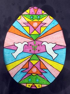 7th Grade - Easter Stained Glass Windows - Symmetry - Marker and Sharpie on copy paper, baby oil over the top, cut out frame using black construction paper