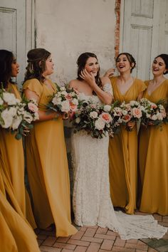 Mustard Yellow Bridesmaids. The Alanna dress features flutter sleeves that create a romantic, delicate silhouette. This long merigold / chartruese chiffon bridal party dress is perfect for a summer, spring or fall boho chic wedding. The soft flutter also lines the dramatic open back. The natural waist seam draws attention to the waist. The full skirt has an above knee slit, creating a romantic billow. This dress is fully lined and has a center back zipper. Photography by Cody and Allison
