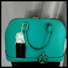 New Vegan Leather Green Bowler Bag PRICE FIRM Has gold tone hardware. zipper closure. metal feet on bottom for protection. Two inside zipper pockets. Two inside slip pockets. Shoulder strap with gold tone hardware. Vegan leather. lead free. Durable material. Bags Totes