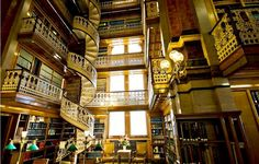 beautiful libraries  A library should be like a pair of open arms. quote by Roger Rosenblatt