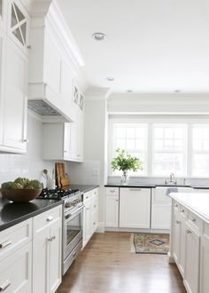 Farmhouse sink and antique rug || Studio McGee classic white kitchen, w/mix of dark and light counters