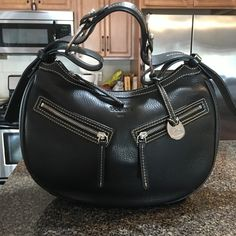 Dooney and Bourke Hobo ( Gorgeous ) bag. Beautiful leather Hobo bag with two front pockets.100% Authentic. Had  it in my closet . Very clean , hardly used.With silver hardware.The price is firm!!!!💯%Authentic. Dooney & Bourke Bags Hobos