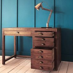 Sturdy reclaimed pine desk with 4 drawers, finished with brass handles ideal for studious spaces.
