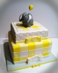 - Yellow quilted baby shower cake with gumpaste elephant.