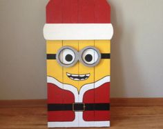 Minion Santa Porch Decoration by CajunGiftsAndMore on Etsy FREE: Access Our Brand New WoodCrafting Guide Christmas Wood Crafts, Pallet Christmas, Outdoor Christmas Decorations, Christmas Signs, Christmas Projects, Christmas Art, Handmade Christmas, Holiday Crafts, Christmas Ornaments