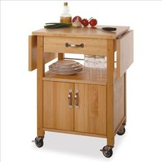 Winsome Wood Drop-Leaf Kitchen Cart Solid/composite wood Kitchen Cart with 2 drop leaves. Rolling drop-leaf cart is ideal for small kitchens that need more workspace Solid beechwood body with brushed nickel hardware and lockable casters Inclu. Microwave Cart, Microwave In Kitchen, New Kitchen, Kitchen Ideas, Wooden Kitchen, Unique Furniture, Kitchen Furniture, Furniture Ideas, Furniture Stores