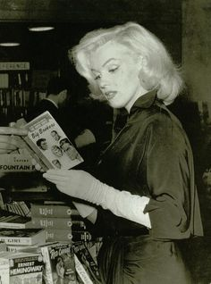 "Marilyn reading ""Big Brokers"""