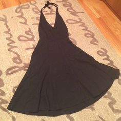Black BCBG MaxAzria Halter Dress Pleated BCBG halter dress with side zip closure, adjustable halter straps and belt that can tie in front or back. I've worn it to formal events but it is casual enough for everyday wear. Size 6 petite but will also fit a four. 100% cotton. Includes an inner lining. Also has pockets! BCBGMaxAzria Dresses